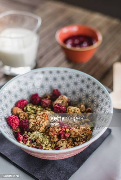 Crunchy Muesli in a Bowl With a Glass of Yogurt and Fresh Fruit