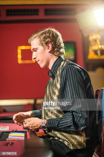 crupier serving card at casino - texas hold 'em stock pictures, royalty-free photos & images