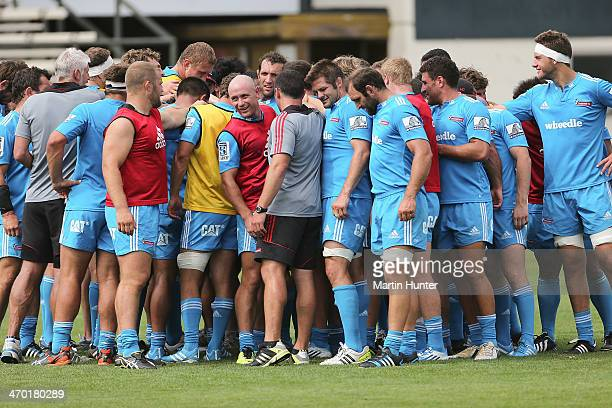 Crusader teammates gather after a Crusaders Super Rugby training session at Rugby Park on February 19 2014 in Christchurch New Zealand