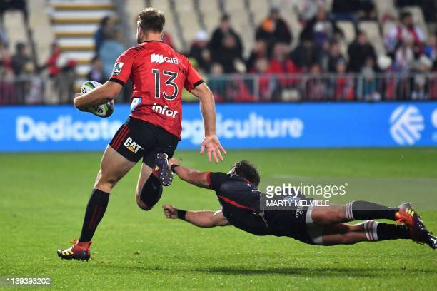 Crusaders' Braydon Ennor is tackled by Lion's captain Kwagga Smith during the Super Rugby match between the New Zealand's Crusaders and South...