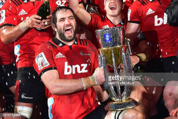Crusaders' captain Sam Whitelock celebrates with the trophy after victory in the Super Rugby final between the Canterbury Crusaders of New Zealand...