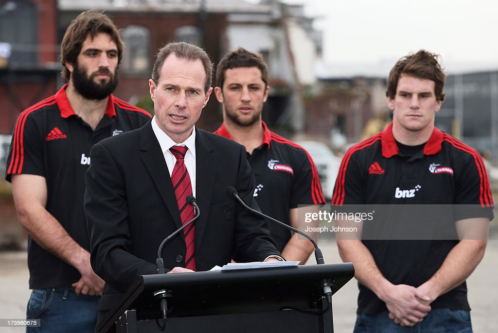 Crusaders CEO Hamish Riach poses with Sam Whitelock, Tom Taylor and Matt Todd during the announcement that BNZ will be naming rights sponsor of the Crusaders on July 19, 2013 in Christchurch, New Zealand.