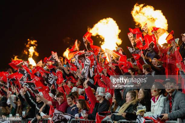 Crusaders fans celebrate scoring a try during the round 15 Super Rugby match between the Crusaders and the Blues at Christchurch Stadium on May 25...
