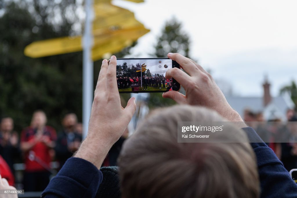 A Crusaders fans takes a photo of the team during a parade at Christchurch Art Gallery on August 8, 2017 in Christchurch, New Zealand. The Crusaders beat the Lions to win the 2017 Super Rugby Final on Saturday night in Johannesburg.