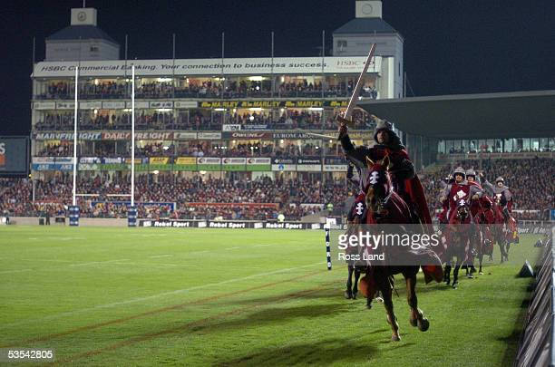 Crusaders horsemen charge around the stadium prior to the 3525 win by the Crusaders over the Waratahs in the final of the Super 12 rugby at Jade...