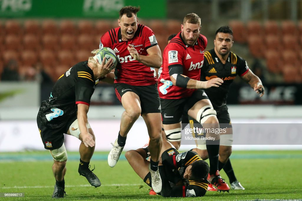 Crusaders Israel Dagg (C) breaks the defence from the Chiefs during the round 16 Super Rugby match between the Chiefs and the Crusaders at Waikato Stadium on June 2, 2018 in Hamilton, New Zealand.