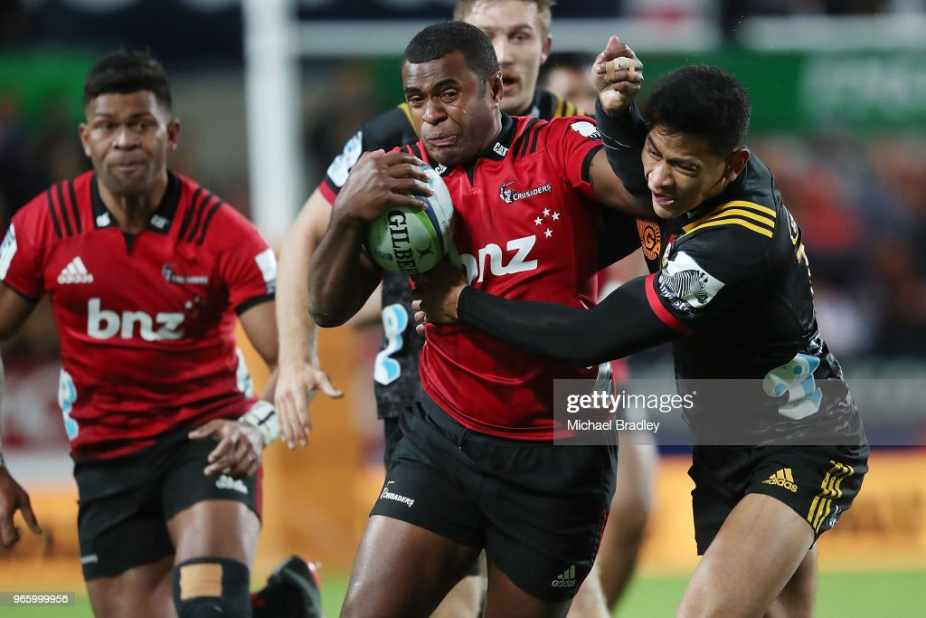 Crusaders Jone Macilai (C) is tackled by Chiefs fullback Solomon Alaimalo (R) during the round 16 Super Rugby match between the Chiefs and the Crusaders at Waikato Stadium on June 2, 2018 in Hamilton, New Zealand.
