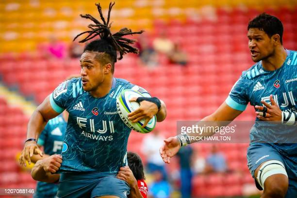 Crusaders' Leicester Faingaanuku is tackled during the Super Rugby match between Japan's Sunwolves and New Zealand's Crusaders in Suncorp Stadium in...