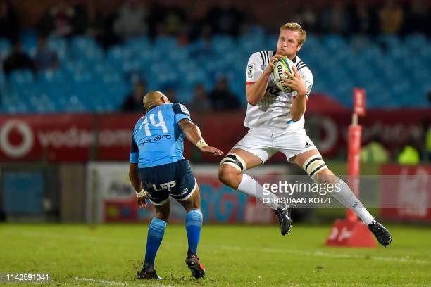 Crusaders' New Zealand lock Mitchell Dunshea grabs the ball past Vodacom Bulls' South African winger Cornal Hendricks during the Super XV Rugby Union...