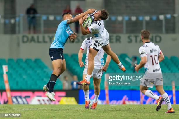 Crusaders player David Havili catches ball under pressure from Waratahs player Israel Folau at round 6 of Super Rugby between NSW Waratahs and...