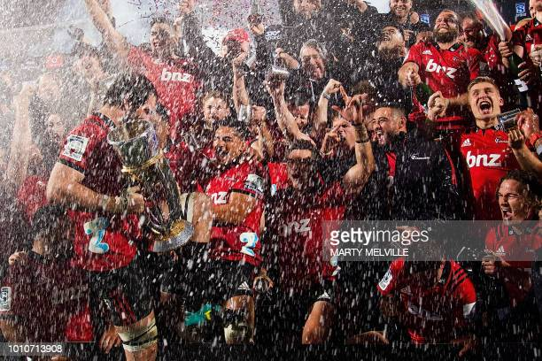 TOPSHOT Crusaders' players celebrate their victory after the Super Rugby final between the Canterbury Crusaders of New Zealand and the Golden Lions...