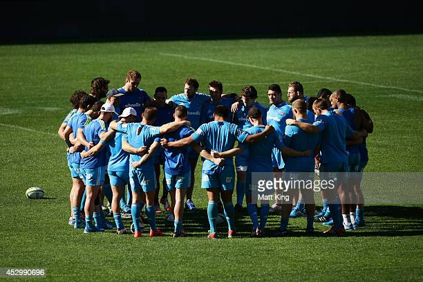 Crusaders players form a huddle and talk tactics during the Crusaders Super Rugby Grand Final Captain's Run at ANZ Stadium on August 1 2014 in Sydney...