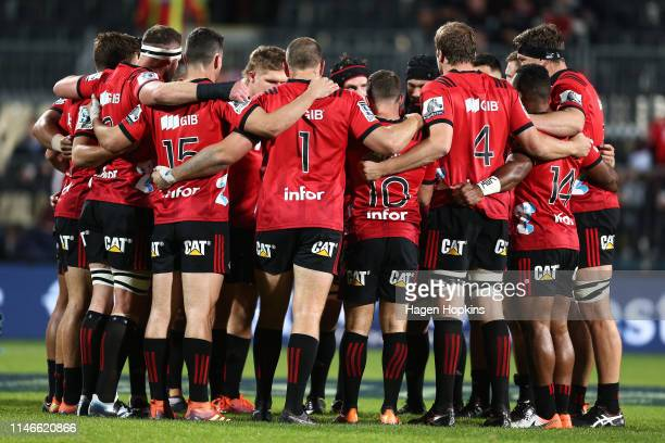 Crusaders players form a huddle during the round 12 Super Rugby match between the Crusaders and Sharks at Christchurch Stadium on May 03 2019 in...