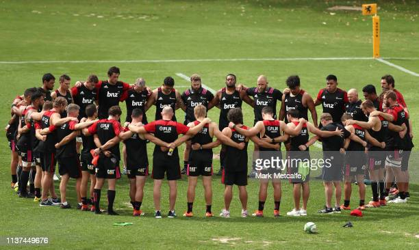 Crusaders players pause training to observe a two minute silence to mark the loss of life in the Christchurch terror attack during a Crusaders Super...