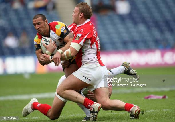 Crusaders RL's Frank Winterstein and Weller Havraki tackle Bradford's Paul Sykes during the Magic Weekend at Murrayfield Edinburgh