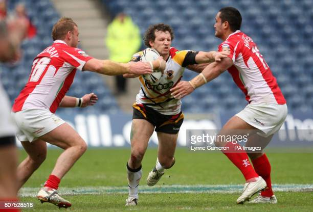 Crusaders RL's Frank Winterstein and Weller Havraki tackle Bradford's Brett Kearney during the Magic Weekend at Murrayfield Edinburgh