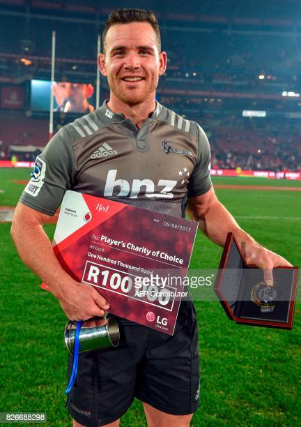 Crusaders' Ryan Crotty poses with his award of man of the match during the price ceremony after winning the Super XV rugby final match between Lions...
