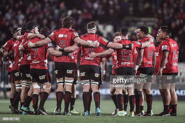 Crusaders team mates during the round 19 Super Rugby match between the Crusaders and the Blues at AMI Stadium on July 14 2018 in Christchurch New...