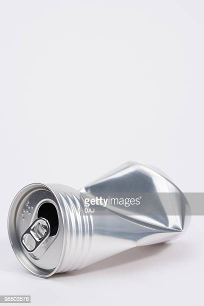 Crushed aluminum can, white background, copy space