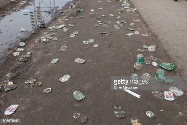 Crushed beer cans are scattered along a road at the 2017 Woodstock Festival Poland on August 4 2017 in Kostrzyn Poland The threeday rock music...