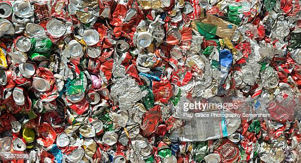 Crushed cans and plastic bottle await recycling.