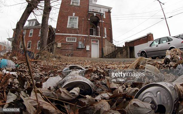 Crushed cans litter the grounds outside the The Phi Kappa Psi fraternity house on the University of Virginia campus on December 6 2014 in...