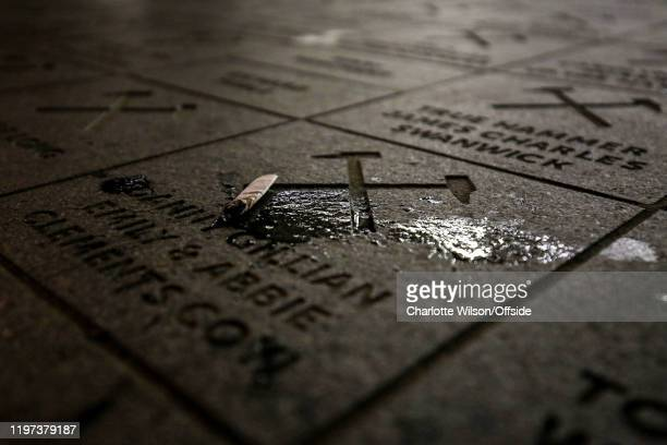 A crushed cigarette butt lies on top of a dedication plaque ahead of the Premier League match between West Ham United and Liverpool FC at London...