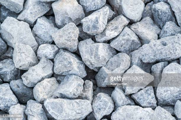 crushed gray rocks on the ground - rock stock pictures, royalty-free photos & images