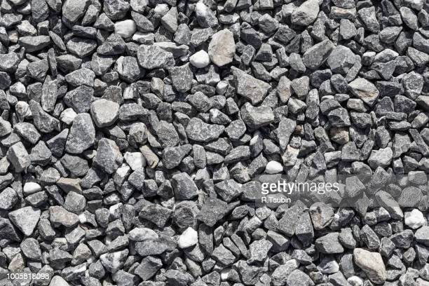 crushed grey stone on the ground texture background - gravel stock pictures, royalty-free photos & images