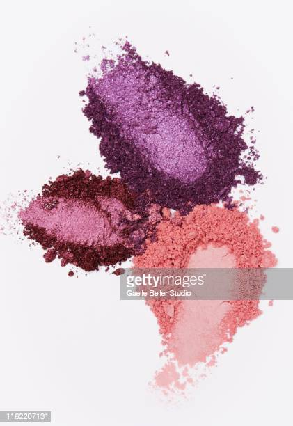 crushed multi colored eyeshadows with finger imprints - eyeshadow stock pictures, royalty-free photos & images