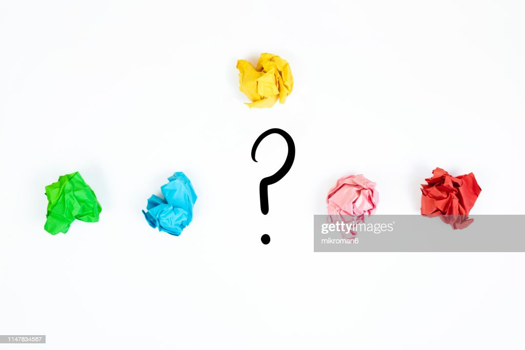 crushed pages of paper and a question mark : Stock Photo