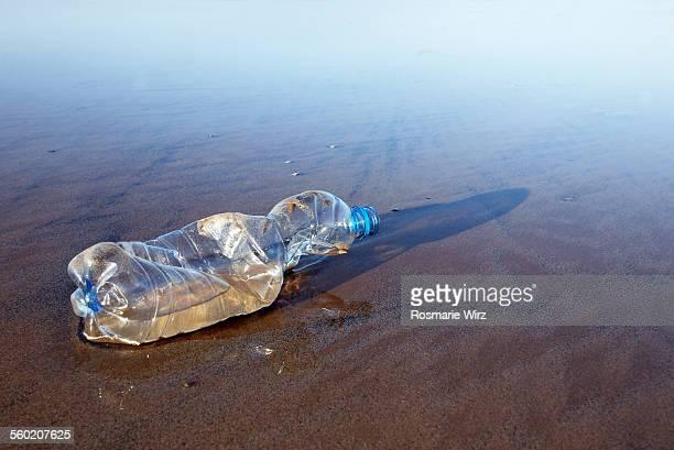 Crushed plastic bottle on beach