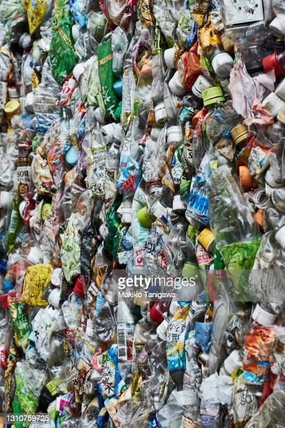 crushed plastic bottles - vertical stock pictures, royalty-free photos & images