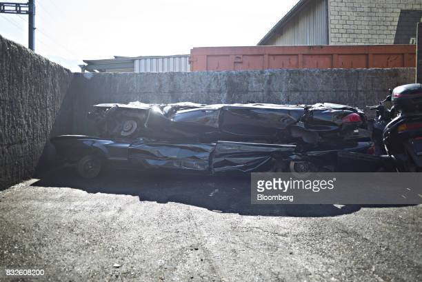 Crushed scrapped limousines sit stacked in the yard at the Autoverwertung Zimmermann GmbH scrapyard in Reichenburg Switzerland on Monday Aug 14 2017...