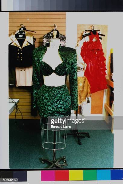 Crushed velvet green floral halter top bolero jacket miniskirt on dressmaker's dummy which was worn by late tejano singer Selena who was killed by...