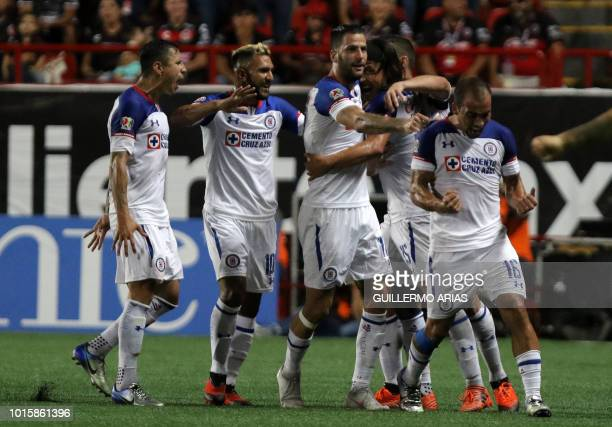 Cruz Azul players celebrate after scoring against Tijuana during their Mexican Apertura 2018 tournament football match at the Caliente stadium in...