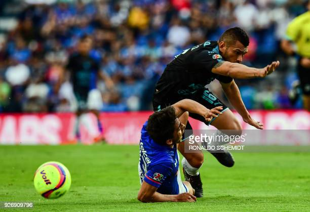 Cruz Azul's Angel Mena vies for the ball with Miguel Samudio of Queretaro during their Mexican Clausura 2018 tournament football match at the Azul...