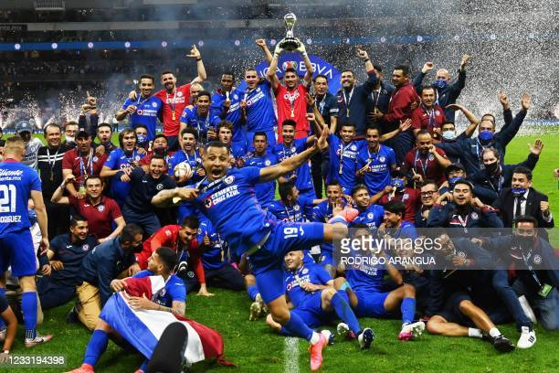Cruz Azul's captain Jesus Corona and teammates celebrate with the trophy after winning the Mexican Clausura final football match against Santos at...