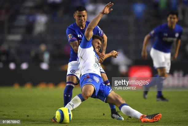 Cruz Azul's defender Julio Cesar Dominguez vies for the ball with Puebla's forward Alejandro Chumacero of Bolivia during their Mexican Clausura 2018...