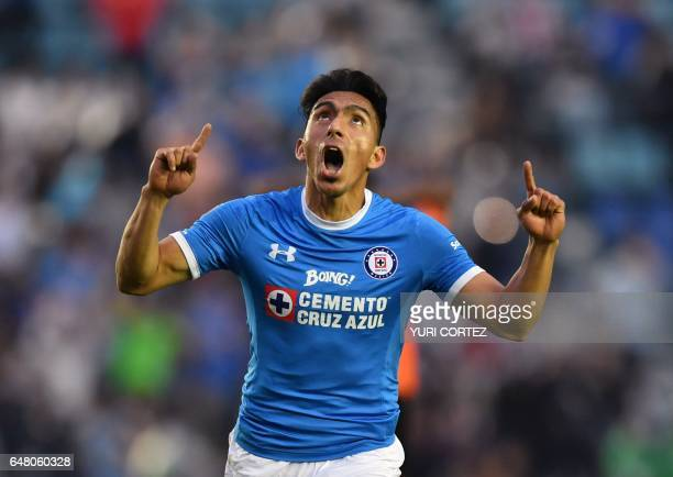 Cruz Azul's forward Angel Mena celebrates after scoring a goal against Chiapas during their Mexican Clausura football tournament match at the Azul...