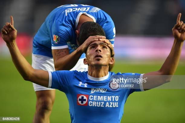 Cruz Azul's forward Angel Mena celebrates with teammate defender Adrian Aldrete after scoring a goal against Chiapas during their Mexican Clausura...