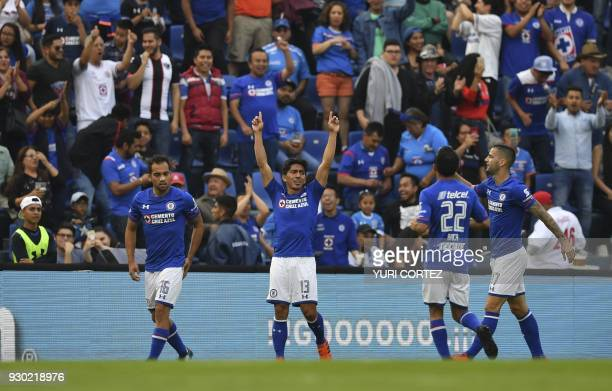 Cruz Azul's forward Angel Mena celebrates with teammates after scoring against Pachuca during their Mexican Clausura football tournament match at the...