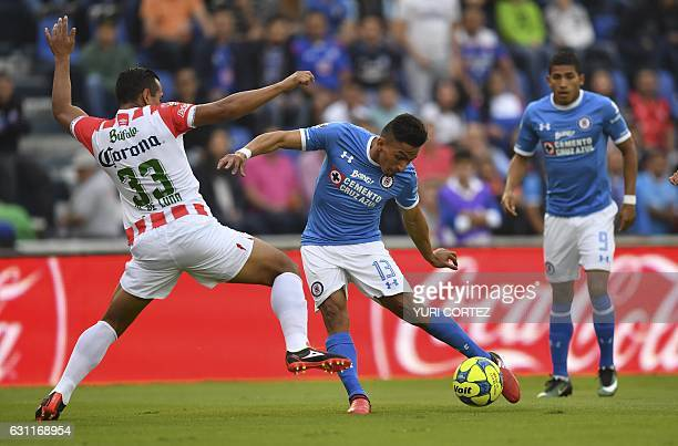 Cruz Azul's forward Angel Mena vies for the ball with Necaxa's defender Mario De Luna during their Mexican Clausura tournament football match at the...