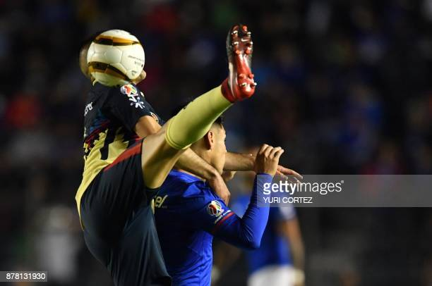 Cruz Azul's forward Felipe Mora vies for the ball with America's defender Paraguayan Pablo Aguilar during their quarter final first leg Mexican...