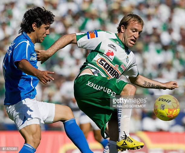 Cruz Azul's Julio Dominguez vies for the ball with Santos' Matias Vuoso during their Mexican football league final match against in Torreon state of...