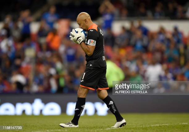 Cruz Azul's Mexican goalkeeper Oscar Perez kisses the ball during the Mexican Apertura football tournament match against Toluca his last match as...