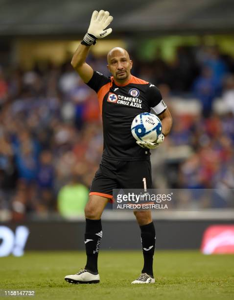 Cruz Azul's Mexican goalkeeper Oscar Perez waves at the crowd during the Mexican Apertura football tournament match against Toluca his last match as...