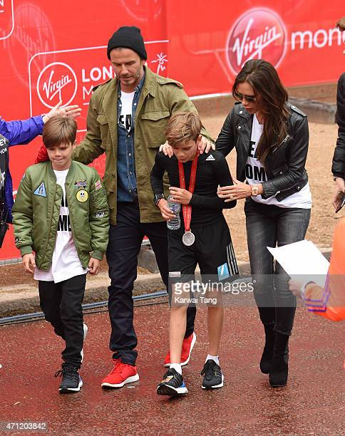 Cruz Beckham David Beckham and Victoria Beckham congratulate Romeo Beckham after he finished the Childrns Marathon during the London Marathon on...