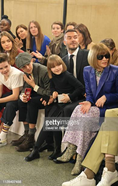 Cruz Beckham Hana Cross Romeo Beckham Harper Beckham David Beckham and Dame Anna Wintour attend the Victoria Beckham show during London Fashion Week...
