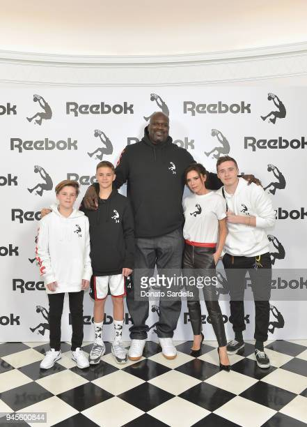 Cruz Beckham Romeo Beckham Shaquille O'Neal Victoria Beckham and Brooklyn Beckham attend an event celebrating Reebok and Victoria Beckham celebrate...